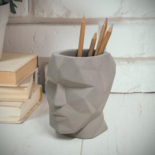 Porte-stylo the head